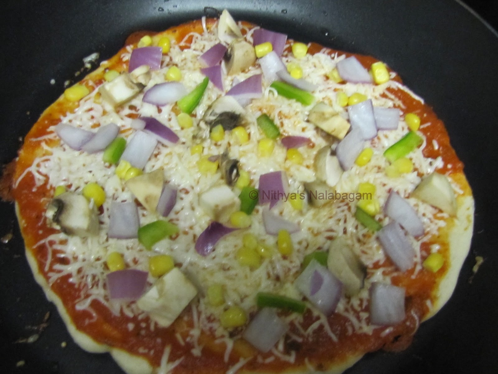 how to cook frozen pizza on stove top