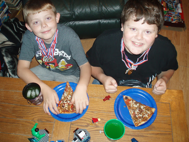Comic Book Boys enjoying Avengers Family Night with Pizza