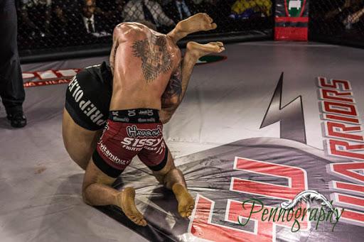 Global Warrior F.C. 2, Alec Ricci vs Kyle Prepolec at Burlington Central Arena in Burlington, Ontario on May 30, 2015. Photo: Jeremy Penn / Pennography  NIKON D7100 AF Zoom 17-55mm f/2.8G 1/800, f/2.8 ISO: 1600