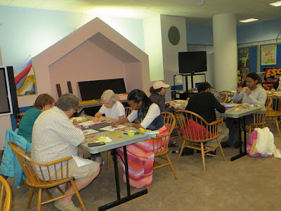photo of adults coloring