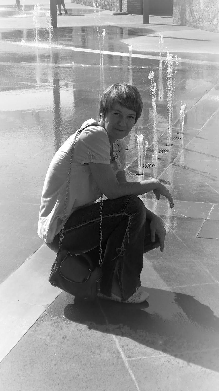 kneeling in front of the water fountain