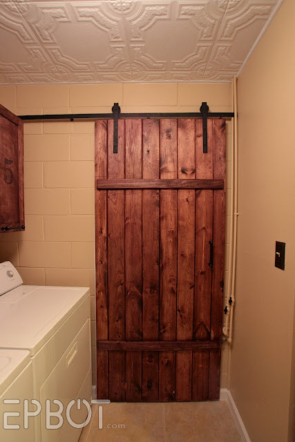 Epbot make your own sliding barn door for cheap - Making a steel door look like wood ...
