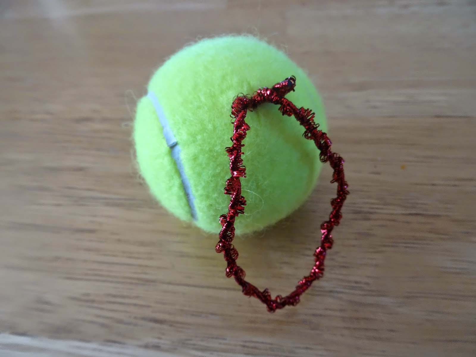 Tennis christmas ornaments - Stuff The Knot Into The Hole In The Top Of The Tennis Ball I Used The Scissors To Help Stuff It In The Ball
