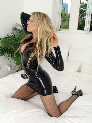Delicious Nadia on the bed in black latex dress and fishnets