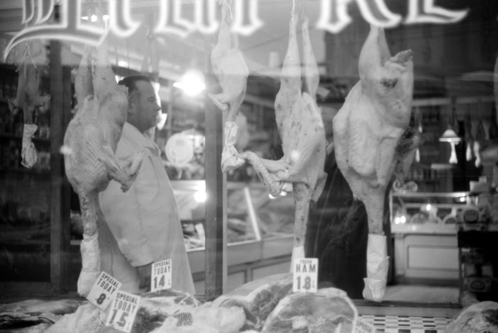 A butcher shop window at Thanksgiving time
