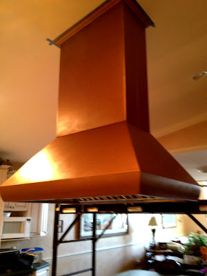 commercial range hood with copper and bronze paint