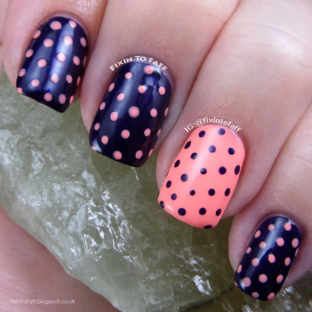 Pastel coral and dark navy blue polka dot nail art, recreation of a look from BeHappyAndBuyPolish.