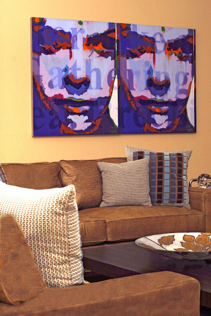 wall art in smashing purple accent decorates the neutral hues living room