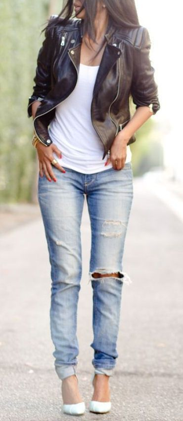 Choose a black leather moto jacket and light blue distressed skinny jeans for a glam and trendy getup