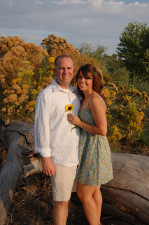 couple standing in front of a flowering tree