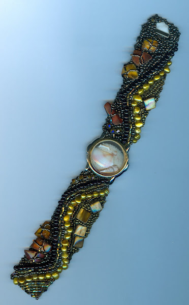 Recycled Watch Face with white coral sand and sea shells, Amber, Fresh Water pearls, and a million