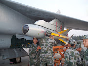 Members of PLAAF Loading KD88 Air To Surface Misssile on JH7 Flying .