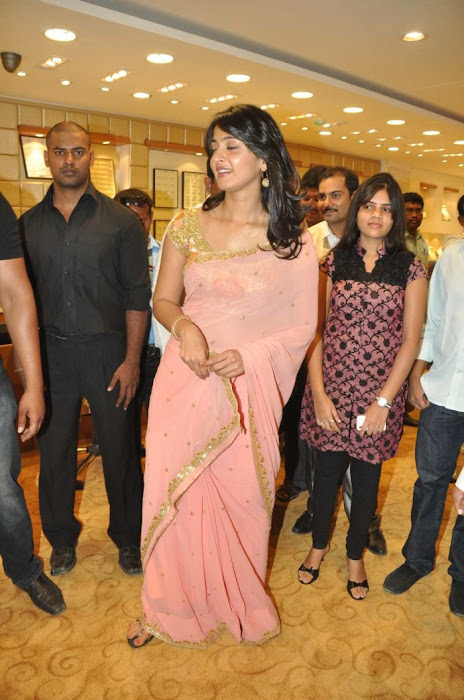 Anushka Shetty in Mustard Saree and Golden Blouse in a Shopping mall images