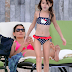 December 2013: Suri sunbathing in Miami
