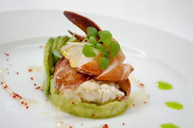 Lobster, Avocado, and Tomato Timbale with Micro Cilantro and Lime.