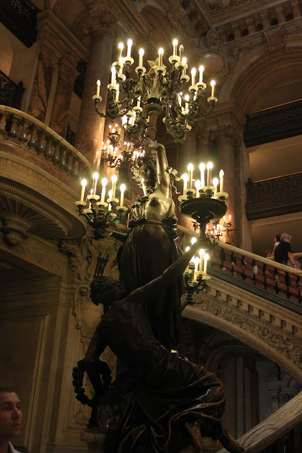 A huge candle stand at The Grand Staircase of Le Palais Garnier in Paris, France