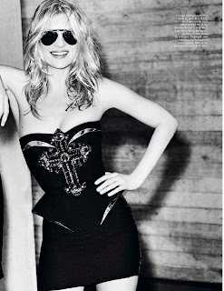 Kate Moss in a black dress and sunglasses
