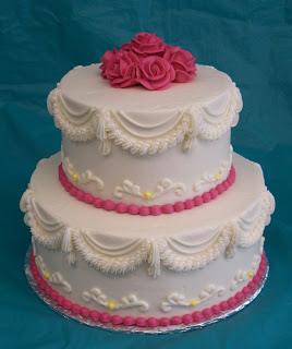 2 tier pink and white wedding cake with pink roses