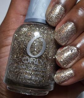 manicured hand holding the polish used: Orly's 'Halo'