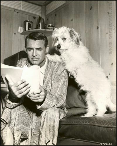 Cary Grant going over a script with his advisor.