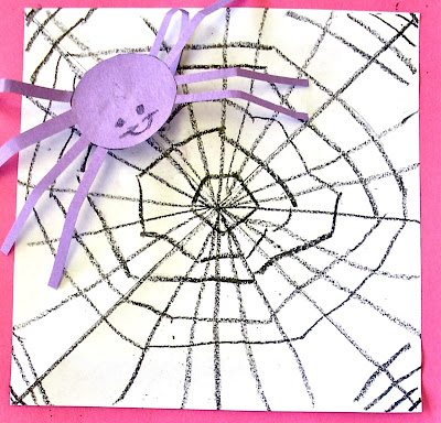 Student drawing lesson on making a spider