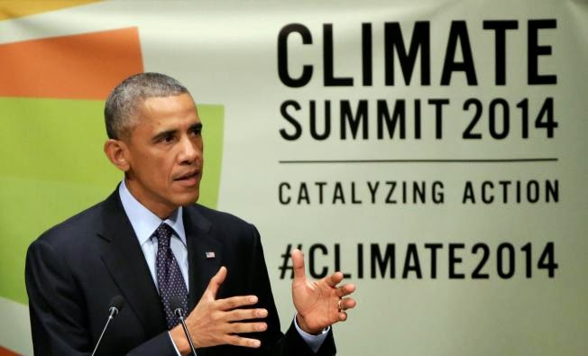 United States President Barack Obama addresses the Climate Summit, at United Nations headquarters, Tuesday, Sept. 23, 2014. (AP Photo/Richard Drew)   Click to enlarge.