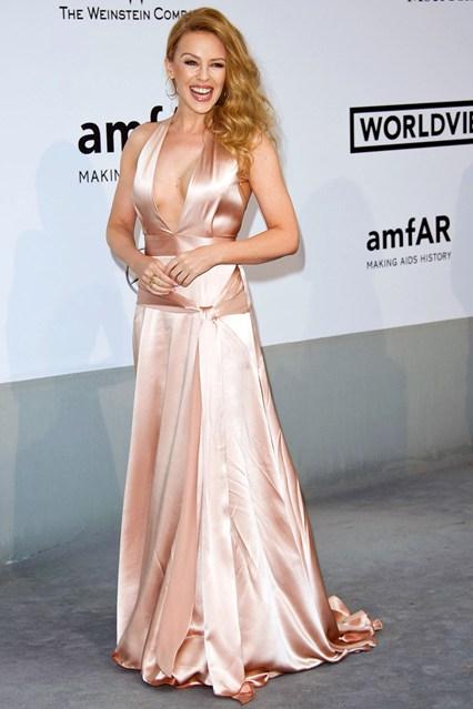Kylie Minogue in a light peach Juan Carlos Obando gown at Cannes, amfAR Gala 2014