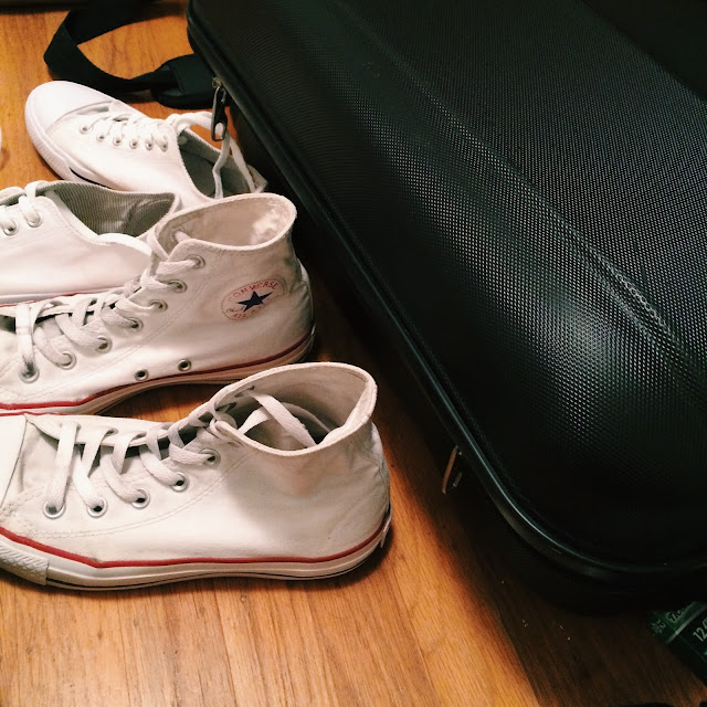 packing with white converse