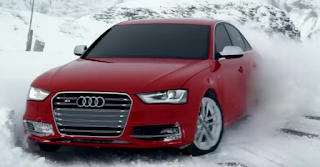 Audi quattro driving in the snow
