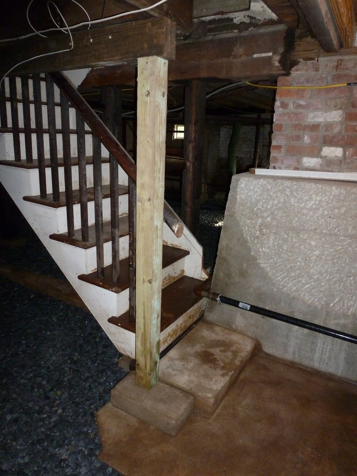 knee walls and three quarter inch blue stone gravel basement
