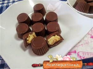 http://www.ricettegustose.it/Cioccolatini_html/Cioccolatini_crema_agli_agrumi_e_nocciole.html