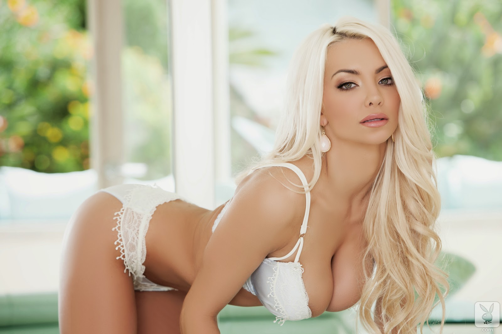 Big tits tight bikini blonde posing