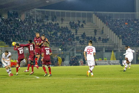 AC Milan forward Mario Balotelli scores from a free-kick against Livorno