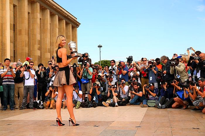 The 27-year-old, Maria Sharapova showed off her offence point in the eyes of public and much of the media while celebrating her glory in a Mini Dress next to the Eiffel tower in Paris, France on Sunday, June 8, 2014