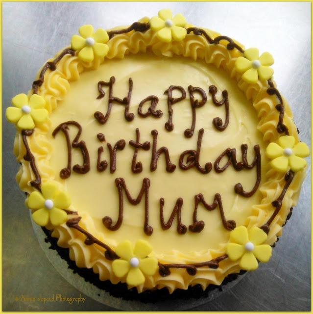 "lemon buttercream cake with the sign 'Happy Birthday Mum"""