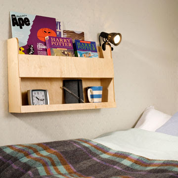 wall-mounted storage shelves intended for use in top of bunk bed; holds books and other items