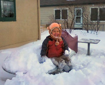 little boy loves snow + sensory processing disorder image
