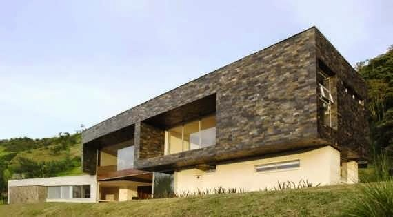 COLUMBIAN CONTEMPORARY FACADE OF GLASS STONE AND CONCRETE