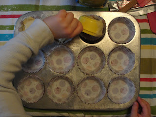 kid making cupcakes