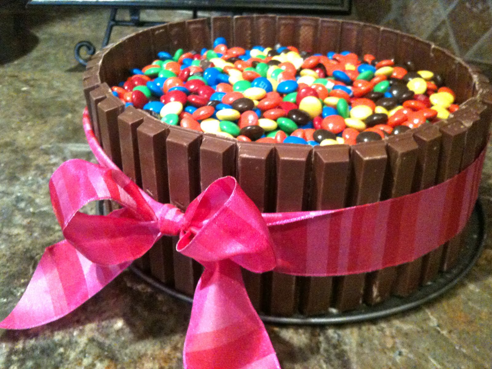 how to make a cake with kit kats around it