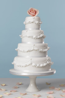 4 Tier White Wedding Cake with Ruffles and Pink Rose