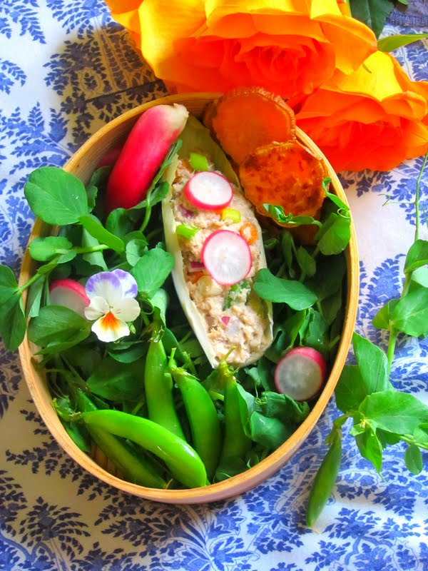 ... salad in a crisp endive leaf springy snow pea tops sugar snap peas