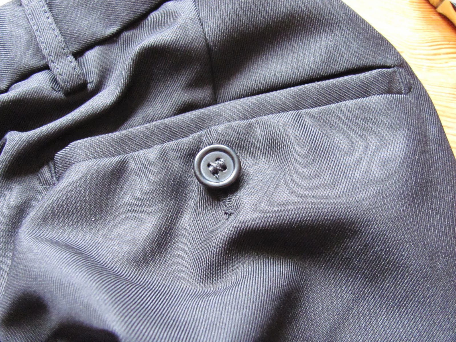 A black back pocket button is fully repaired