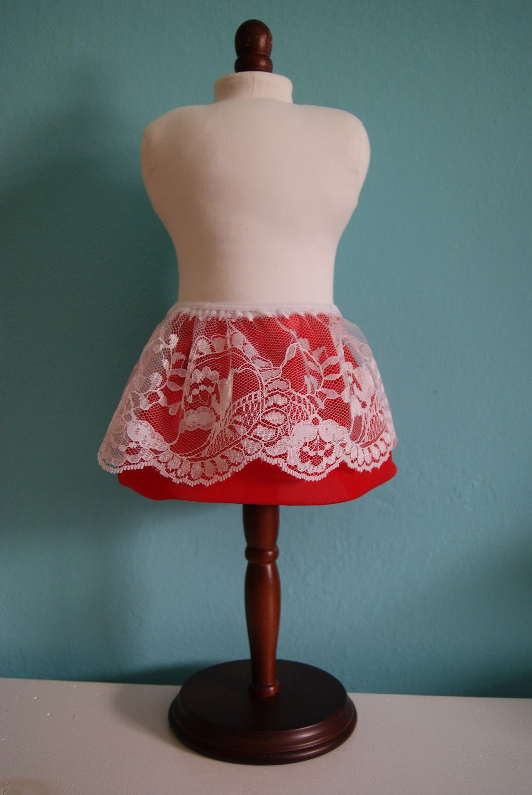 lace skirt on top of red chiffon bubble skirt for 18-inch doll by nest full of eggs