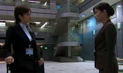 Misaki and Ueno speak in the airport lobby.