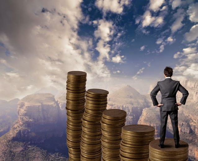 Man on stacks of money on a mountain top (Credit: Shutterstock) Click to enlarge.