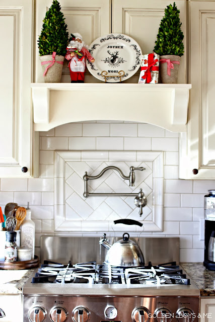 Mantel range hood at Christmas with preserved boxwoods, whote subway tile, and Belle Forest pot filler-www.goldenboysandme.com