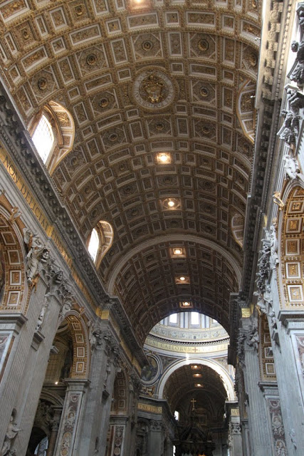 The details of the arts design on the ceiling of St Peter's Basilica in Vatican City, Rome, Italy