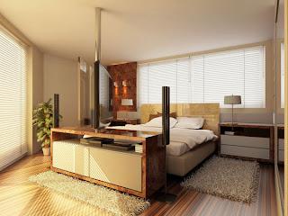 Tapetes retangulares nas laterais da cama de casal.