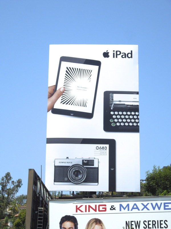 Apple iPad book typewriter camera billboard